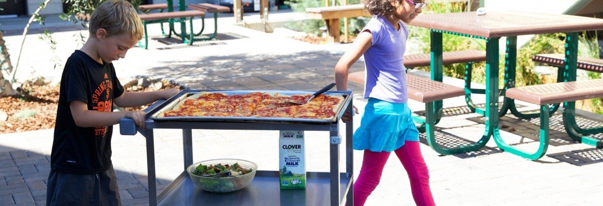 Walking the lunch cart back to Second Grade on pizza day.