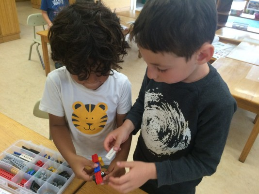 Using collaboration skills to build Lego constructions.