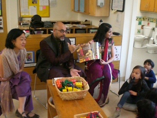 South Class students learn about Diwali through a read aloud led by parents.